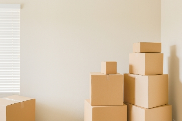 photo of boxes stacked in an empty room